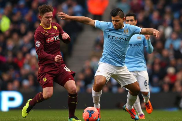 hi-res-465008795-sergio-aguero-of-manchester-city-holds-off-a-challenge_crop_north
